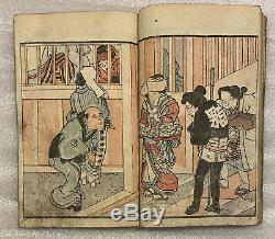 Rare shunga book, couple both dressed as women, street outside a brothel, 1830s